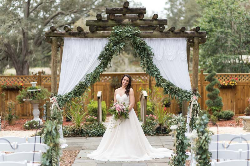 bride standing in front of ceremony space at Harmony Gardens