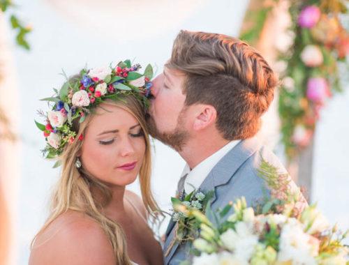 groom kiss brides forehead on wedding day