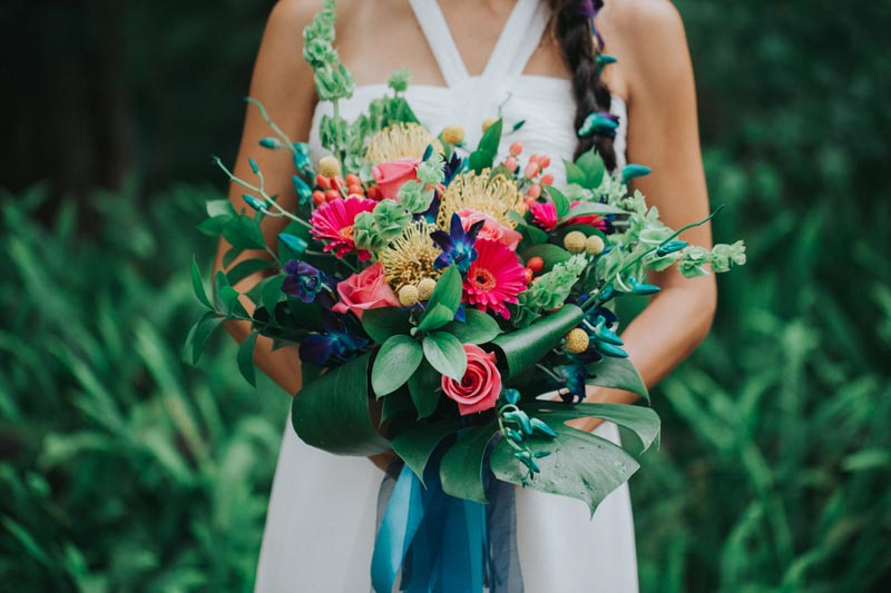 bride holding tropical wedding bouquet