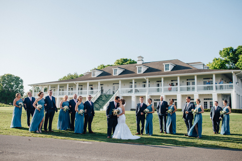 couple with wedding party in front of Tuscawilla Country Club