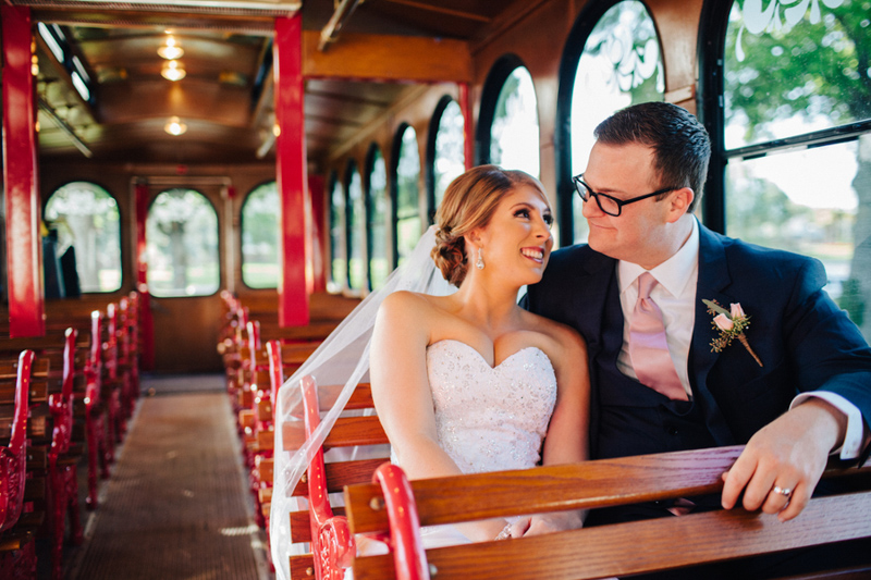 Bride and groom on trolly after wedding ceremony