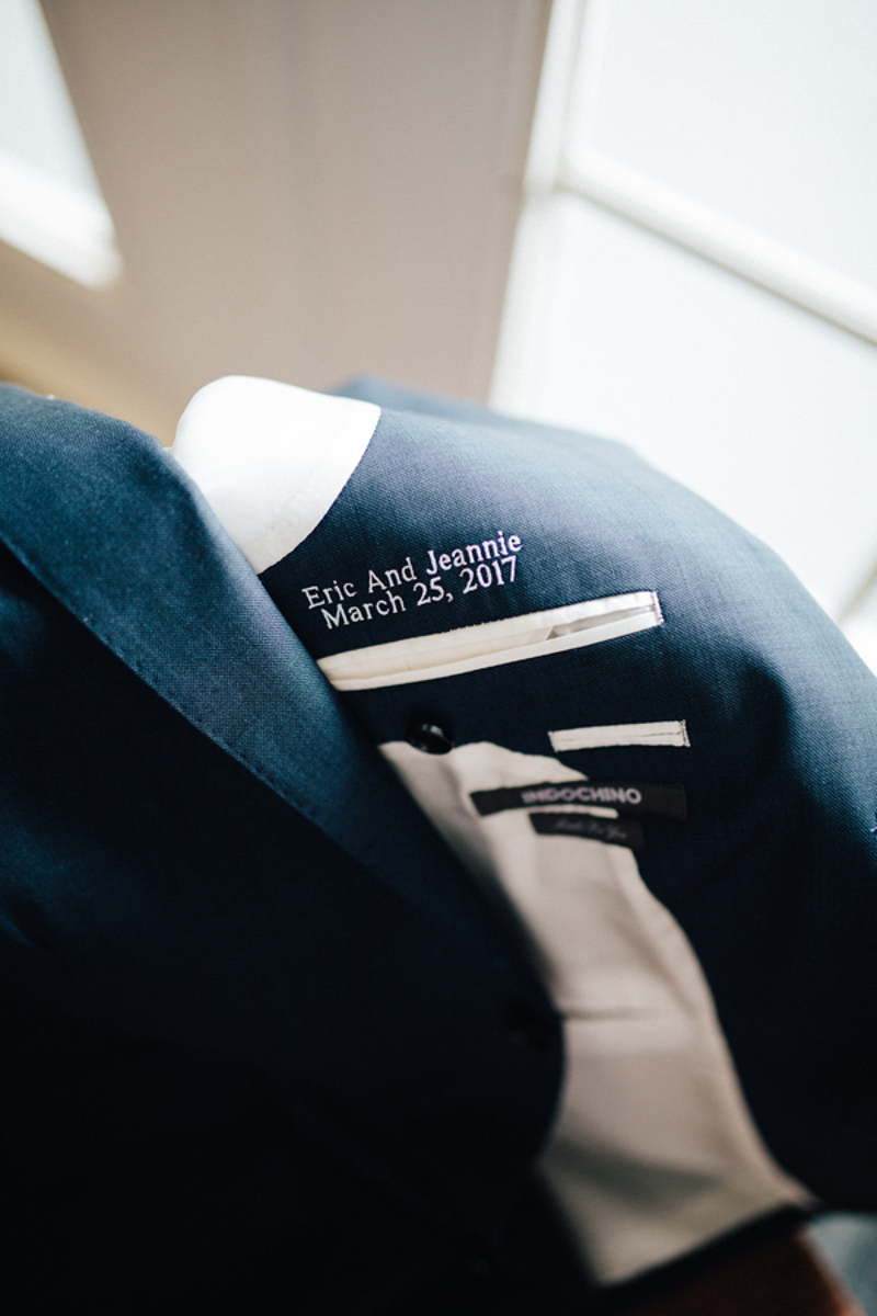 couple's wedding date embroidered on suit jacket