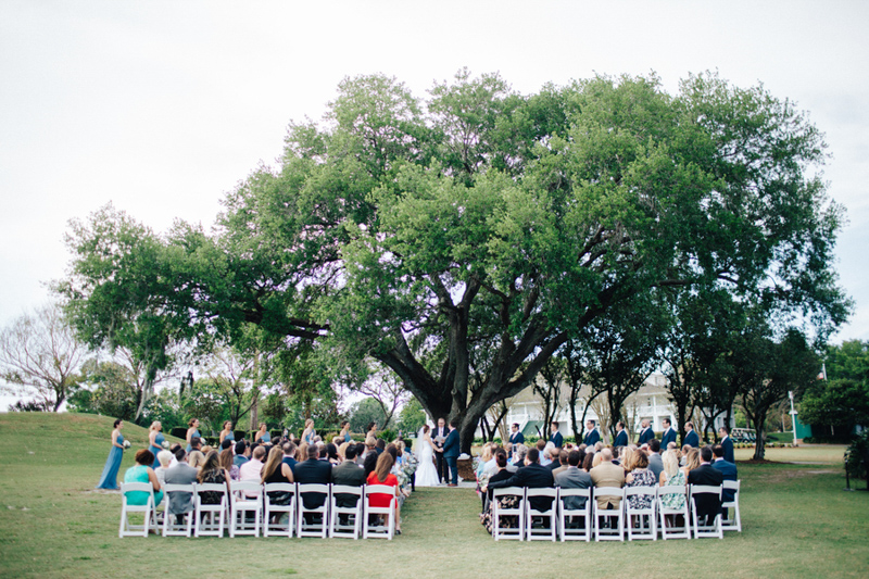 wedding ceremony under oak tree at Tuscawilla Country Club