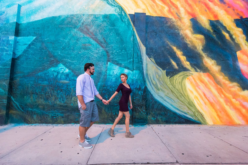 Couple walking in front of Florida Tech wall mural