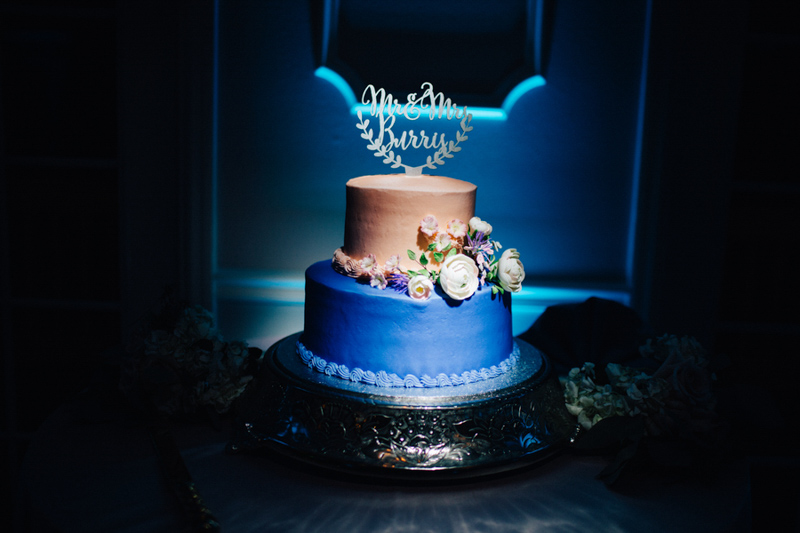 blush and blue buttercream wedding cake on silver cakestand