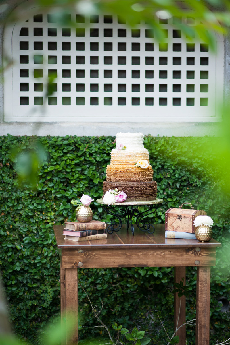 ombre wedding cake on square farm table